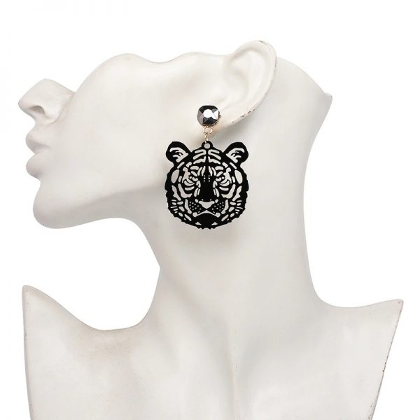 ed95d32a be2e 5700 b72c 98d6db269d6b » CHRISTI TASKER MIAMI » Designer Fashion Jewelry & Home Decor Boutique » Acrylic Rhinestone Eye of the Tiger Earrings » One of my all-time favorite designs which is originally inspired by Siegfried & Roy the white tiger show in Las Vegas. They also look a little like Gucci. I've created this design in gold cutwork metal and now the tigers are in detailed cutwork acrylic with a rhinestone earring fastener. Super lightweight and easy to wear, these tiger earrings are showstoppers. Seriously, I get so many compliments when I wear these. They're a great way to start a conversation.