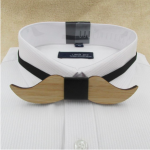 f83c1116 1edf 5207 9d75 3ebe4e980b14 » CHRISTI TASKER MIAMI » Designer Fashion Jewelry & Home Decor Boutique » Mustache Bamboo Wooden Geometric Bow Tie » Stand out in the crowd with my gold feathers men's bow tie. Handmade with gold brushed feathers tied with a clean banded gold shiny center, this bow tie is a statement piece of art. Wear it with jeans and a vest or nice jacket for daily high-fashion wear or switch out boring black-ties for your next event.