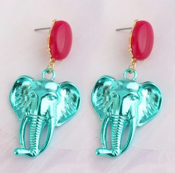 5249d273 67e7 5b82 88c4 0aa62fdf59ac » CHRISTI TASKER MIAMI » Designer Fashion Jewelry & Home Decor Boutique » Chromatic Creative Elephant Earrings | Female Empowerment » My colorful chromatic elephant earrings are an artistic reminder that women need to stick together and support each other. The elephant is one of nature's many reminders that women are great leaders, especially in groups. They are creative communicators with long memories. Wear these elephant earrings with the pride of leadership and freedom. Like an elephant's tusk, never stop growing. Be like an elephant, welcome 'strangers' to join you. Enjoy the compliments you'll receive and the conversations you'll start with these elephants hanging around