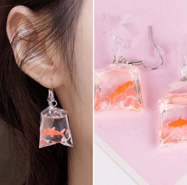 "75183534 93cb 5d0e beca ca0b9d0348ff » CHRISTI TASKER MIAMI » Designer Fashion Jewelry & Home Decor Boutique » Coral Conservation Acrylic Earrings | Let's Build Our Fish a New Coral Home » Let's grow new corals and give fish their natural habit back! My handmade acrylic goldfish earrings resemble ""fish out of water with no natural habitat"". A portion of the proceeds of each of my Gone Saltwater Fishing earrings will benefit Mote Laboratory to assist in the continued works of David Vaughan. He is the scientist who accidentally discovered a new coral fragmentation method which is growing coral 40 times faster than in the wild. Coral is an imperative part of our ecosystem that has been severely affected by global warming. As a trained scuba diver, I would love to see David's discoveries work in the wild. Normal coral sexual maturity takes anywhere from 25 to 75 years. David's accidental new coral fragmentation discovery in Mote Laboratory too just 3 years. Conservationists and Scientists plan to plant 100,000 pieces of coral around the Florida Reef Tract by the end of 2019. Millions more around the world need to be planted in the years to come. With each purchase of each pair of ""Gone Saltwater Earrings,"" you'll be helping in the new coral growth efforts."