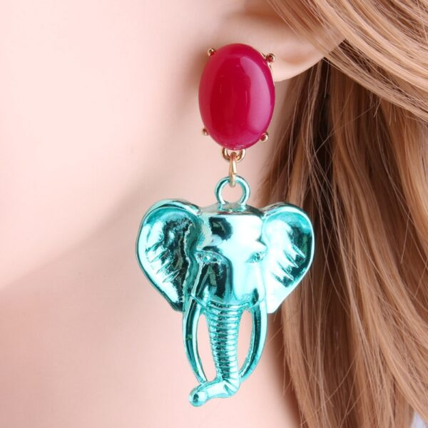 af82128f 18b6 533c 9035 a0addc7a7fa7 » CHRISTI TASKER MIAMI » Designer Fashion Jewelry & Home Decor Boutique » Chromatic Creative Elephant Earrings | Female Empowerment » My colorful chromatic elephant earrings are an artistic reminder that women need to stick together and support each other. The elephant is one of nature's many reminders that women are great leaders, especially in groups. They are creative communicators with long memories. Wear these elephant earrings with the pride of leadership and freedom. Like an elephant's tusk, never stop growing. Be like an elephant, welcome 'strangers' to join you. Enjoy the compliments you'll receive and the conversations you'll start with these elephants hanging around