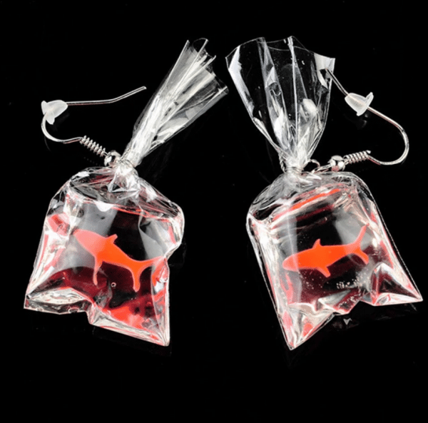 "fa72943b 2dd1 557c 819e 90e08f372804 » CHRISTI TASKER MIAMI » Designer Fashion Jewelry & Home Decor Boutique » Coral Conservation Acrylic Earrings | Let's Build Our Fish a New Coral Home » Let's grow new corals and give fish their natural habit back! My handmade acrylic goldfish earrings resemble ""fish out of water with no natural habitat"". A portion of the proceeds of each of my Gone Saltwater Fishing earrings will benefit Mote Laboratory to assist in the continued works of David Vaughan. He is the scientist who accidentally discovered a new coral fragmentation method which is growing coral 40 times faster than in the wild. Coral is an imperative part of our ecosystem that has been severely affected by global warming. As a trained scuba diver, I would love to see David's discoveries work in the wild. Normal coral sexual maturity takes anywhere from 25 to 75 years. David's accidental new coral fragmentation discovery in Mote Laboratory too just 3 years. Conservationists and Scientists plan to plant 100,000 pieces of coral around the Florida Reef Tract by the end of 2019. Millions more around the world need to be planted in the years to come. With each purchase of each pair of ""Gone Saltwater Earrings,"" you'll be helping in the new coral growth efforts."